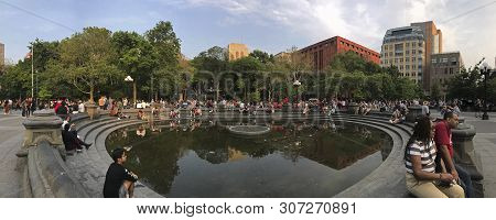 New York, New York/usa - June 1, 2019: Wide Angle Of People Sitting At The Washington Square Park Fo