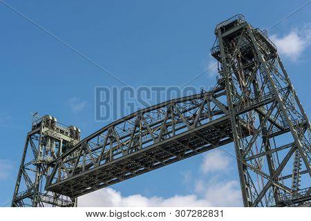 Top Of Monumental Koningshaven Railway Bridge - De Hef - Against Blue Sky In Rotterdam, Netherlands