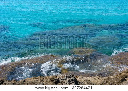 Transparent Azure Waters With Rocky Bottom Near Mountainous Crete Island, Greece.
