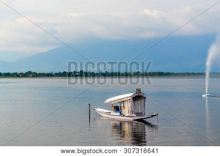 A House Boat Or Shikara Boat Ride On Dal Lake Srinagar, Jammu And Kashmir, India. The Great Himalaya
