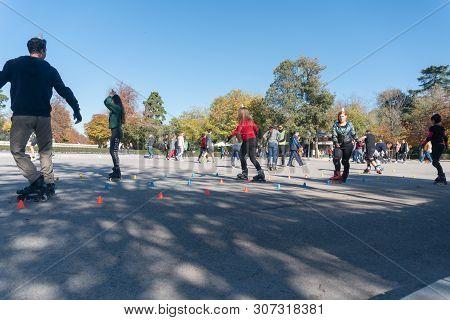 Madrid, Spain - November 12,2017 : Unidentified People Practice Roller Skating Course In Retiro Park