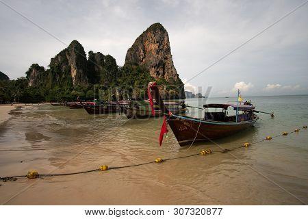 Railay Beach, Thailand - May 7, 2016 : Row Of Wooden Boats On Railay Beach, Thailand.