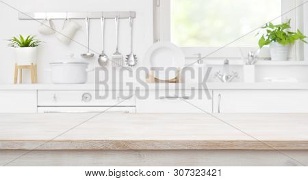 Wooden Table Top On Defocused Kitchen Room And Window Background