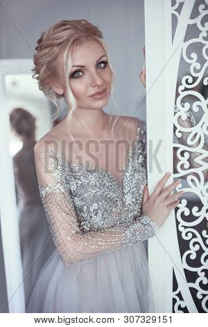 Beauty Portrait Of Pretty Bride Wearing Fashion Wedding Dress. Elegant Fiancee With Make-up And Hair