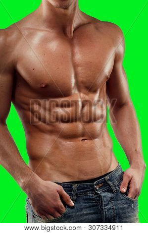 Closeup Of A Shirtless Man In Jeans, Showing A Six Pack Abs Abdominal Relief, Of A Green Screen Chro