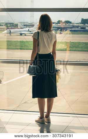 Traveler Girl On Airport In Vacation. Young Traveler Girl In Vacation. Girl Traveling By Airplane In
