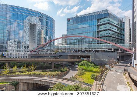 La Defense, Paris - April 14, 2019 : Kupka Chrome And Glass Pedestrian Bridge And Glass Buildings Ex