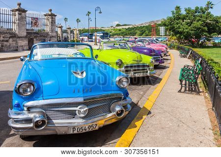 Havana, Cuba-october 07, 2016. Old Classic American Cars, Used As Taxi, Parked Next To Popular Touri