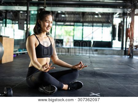 Asian Beautiful Women Are Practicing Yoga With Meditation Lotus In Fitness Gym. Exercise Concept And