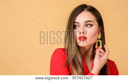 Fashion Trend. Jewelry Shop. Girl Model Long Hair Demonstrating Golden Jewelry Earrings. Expensive A