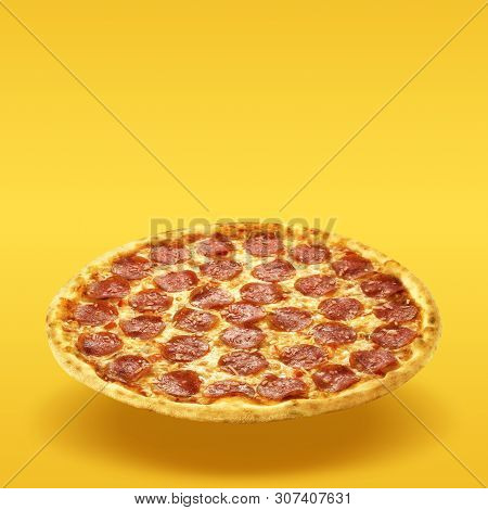 Creative Layout Of Hot Delicious Pizza In Flying On Summer Orange Background. Pizza Pepperoni Design