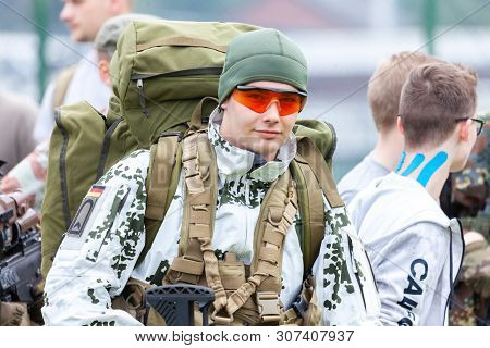 Augustdorf / Germany - June 15, 2019: German Mountain Trooper In Snow Camouflage Suit Walks At Day O