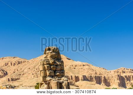 Memnon Colossi (statues Of Pharaoh Amenhotep Iii) In Luxor, Egypt