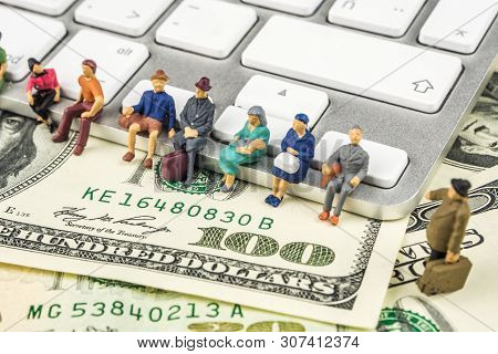 Business Concept, Closeup Of Miniature Figurine Of People Sitting On The Edge Of Keyboard And Waitin