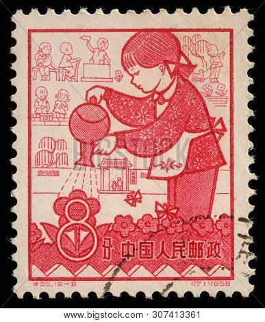 ZAGREB, CROATIA - SEPTEMBER 08, 2014: A stamp issued in the China shows Nursery, the 1st Anniversary of People's Communes, circa 1959.