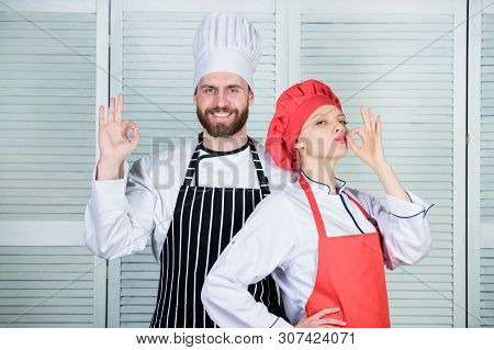 Cooking with your spouse can strengthen relationships. Reasons couples cooking together. Teamwork in kitchen. Couple cooking dinner. Woman and bearded man culinary partners. Delicious family dinner poster
