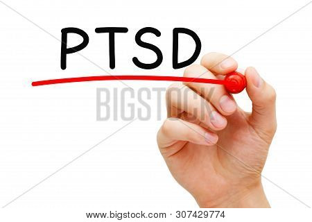 Hand Writing Ptsd Post Traumatic Stress Disorder With Marker On Transparent Wipe Board.