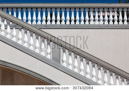 Staircase With Railings And Balustrades Against The Wall With Balustrades At The Top Of The Building