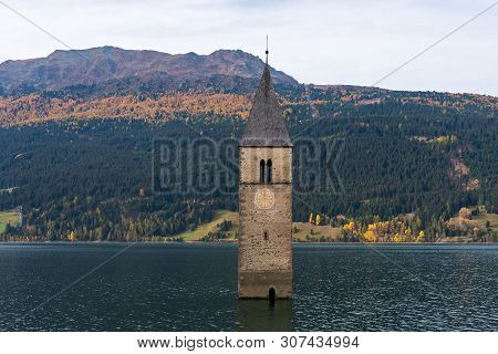 The Famous Bell Tower In The Lake Of Reschen - Lago Di Resia In South Tyrol, Italy. During Ww2 A Dam