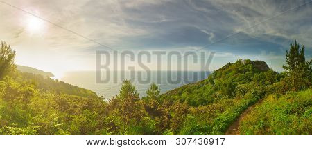 Pasajes (pasaia), Spain - June 16, 2019. Panoramic View Of Monte Ulia Mount At Sunset With The Faro