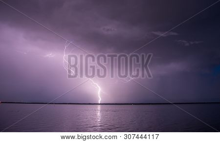 A Lighting Bolt Strikes During A Thunderstorm.