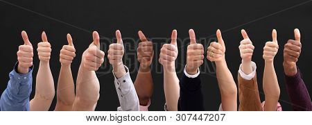 People Hand Showing Thumb Up Sign Against Black Backdrop