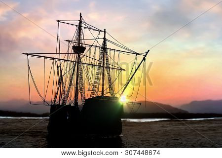 Pirate Ship Sailboat At The Open Sea During  Sunset