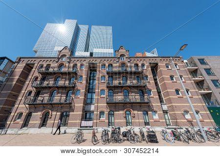 Rotterdam, Netherlands - April 18, 2019 : Ancient Dutch Building Against De Rotterdam Buiding And Bl