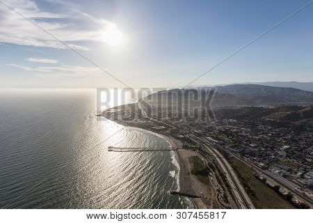 Aerial view of afternoon sun over Ventura Pier in Southern California.