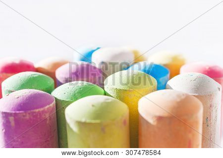 Jumbo Sidewalk Chalk, Assorted Colors, Bold Tips On White Background. Side View.