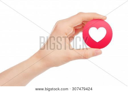 Kiev, Ukraine - May 15, 2019: Hand Holds New Facebook Love Empathetic Emoji Reaction, Printed On Pap