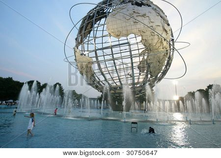 NEW YORK - JUNE 25:  Children play in the water fountain area of the Unisphere for some relief to the heat on June 25, 2005 in Flushing, NY.