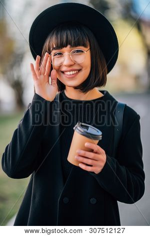Young Mixed Woman Use Mobile Phone And Smiling In Urban Background. Young Girl Wearing Casual Clothe