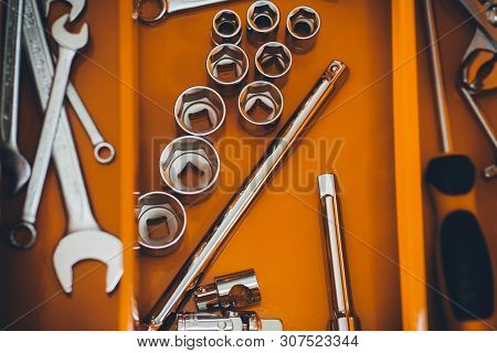 Repairman Red Toolbox With Wrench Kit. Chrome Tools For Automobile Repair In Garage.