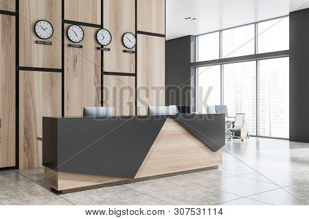 Wooden And Gray Reception In Office With Clocks