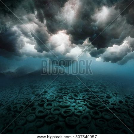 Polluted Underwater World. Aftermath Of Wave Crash With A View Of Discarded Old Tires. 3d Illustrati