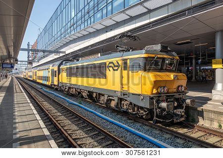 Utrecht, The Netherlands - May 15, 2018: Railway Station Utrecht With Waiting Train And Travelers