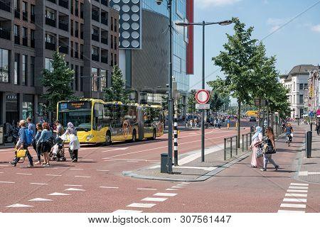Utrecht, The Netherlands - July 05, 2018: Cityscape Dutch City Utrecht With Urban Bus Waiting For Pe