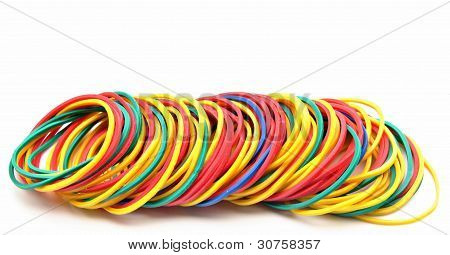 Colored rubber bands next to each other surrounded by white background poster
