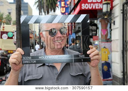 6/18/2019 Hollywood: California:  Tourist Visit Hollywood and enjoy sights, sounds, and smells of street performers and homeless alike on the streets of Hollywood in Los Angeles California. Editorial