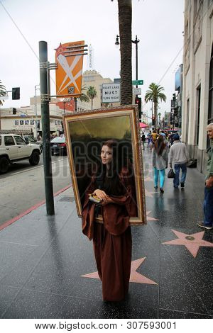 6/18/2019 Hollywood, California: Street Scenes of Hollywood California with street vendors, street performers, homeless, tourist, landmarks and various buildings with signs. Editorial Use Only.