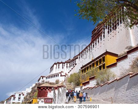 Tibet, China - May 2019: Pilgrims Visiting Potala Palace In Lhasa, Tibet