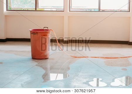 Red Bucket Underlie Water Leak Interior Office Building In From Ceiling