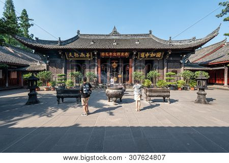 Chengdu, Sichuan Province, China - June 6, 2019 : People Praying With Burning Incense Sticks On A Su