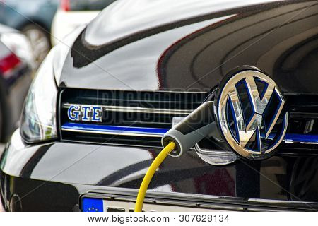 Herzogenaurach, Germany - June 23, 2018: A Volkswagen Golf Gte Is Charged At A Charging Station. The