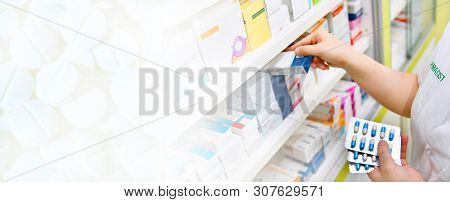 Pharmacist Holding Medicine Box And Capsule Pack In Pharmacy Store And White Pill Background For Cop