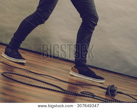 Man Leg And Guitar Audio Stomp Box Effects Cables In Music Studio