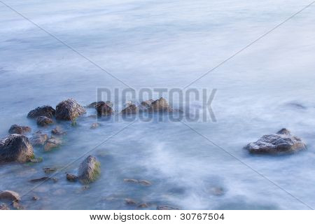 Sea Coast With Waves In Motion Blur.