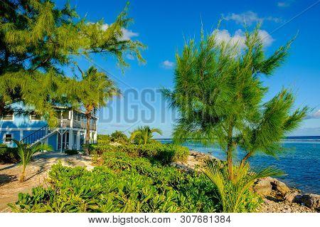 Little Cayman, Cayman Islands, Nov 2018, Blue Caribbean-style House On South Hole Sound