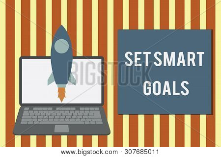 Writing note showing Set Smart Goals. Business photo showcasing giving criteria to guide in the setting of objectives Launching rocket up laptop Startup Developing goal objective. poster